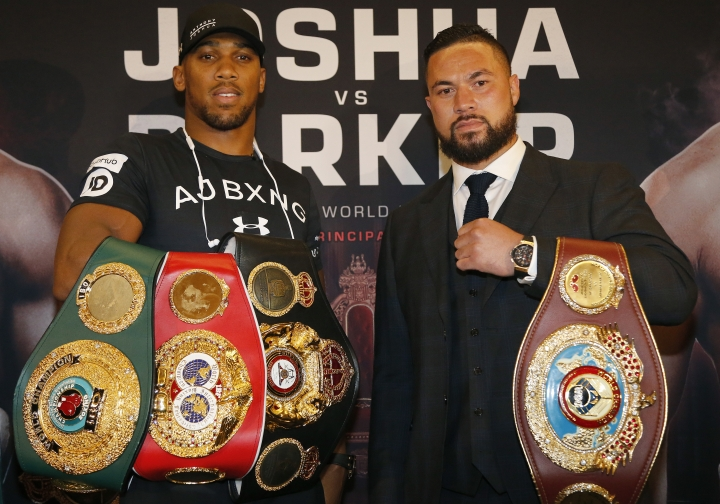 World Heavyweight boxers Anthony Joshua of Britain, left, and New Zealand's Joseph Parker hold their belts as they pose for photographers after a media conference in London, Tuesday, Jan. 16, 2018. Their unification title bout with Joshua's IBF, WBA (Super) and IBO heavyweight titles and Parker's WBO heavyweight title on the line will take place at the Principality Stadium in Cardiff on March 31, 2018.(AP Photo/Frank Augstein)