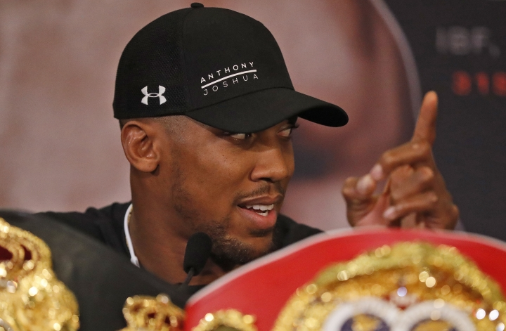 World Heavyweight boxers Anthony Joshua of Britain speaks during a media conference with New Zealand's Joseph Parker in London, Tuesday, Jan. 16, 2018. Their unification title bout with Joshua's IBF, WBA (Super) and IBO heavyweight titles and Parker's WBO heavyweight title on the line will take place at the Principality Stadium in Cardiff on March 31, 2018.(AP Photo/Frank Augstein)