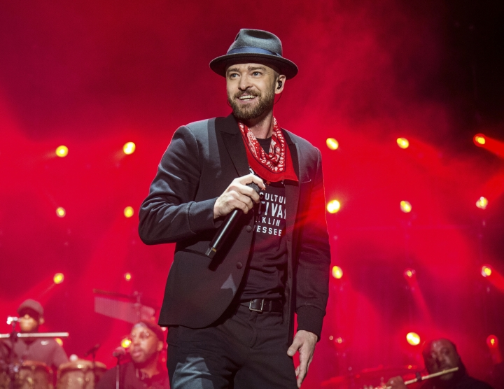 "FILE - In this Sept. 23, 2017 file photo, Justin Timberlake performs at the Pilgrimage Music and Cultural Festival in Franklin, Tenn. Timberlake previewed his new album ""Man of the Woods"" Tuesday, Jan. 16, 2018, at a venue that was decorated with bushes and trees, and served ants coated in black garlic and rose oil and grasshoppers, showcasing the album's theme. Timberlake, who will headline next month's Super Bowl halftime show, worked again with his mega-producer Timbaland on the album. First single and album opener, ""Filthy,"" debuted at No. 9 on the Billboard Hot 100 chart this week. (Photo by Amy Harris/Invision/AP, File)"