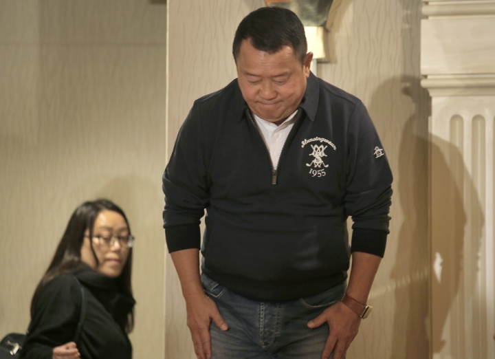 Hong Kong actor Eric Tsang bows at the end of a press conference in Hong Kong, Wednesday, Jan. 17, 2018. Tsang vehemently denies rumors of allegedly sexual harassment made against him. Tsang said that all accusations are fabricated. (AP Photo/Vincent Yu)