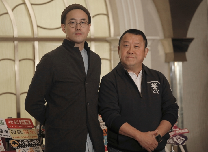 Hong Kong actor Eric Tsang, right, poses with his director son, Derek Tsang for photographers before a press conference in Hong Kong, Wednesday, Jan. 17, 2018. During the press conference, Tsang vehemently denied rumors of allegedly sexual harassment made against him. Tsang said that all accusations are fabricated. (AP Photo/Vincent Yu)