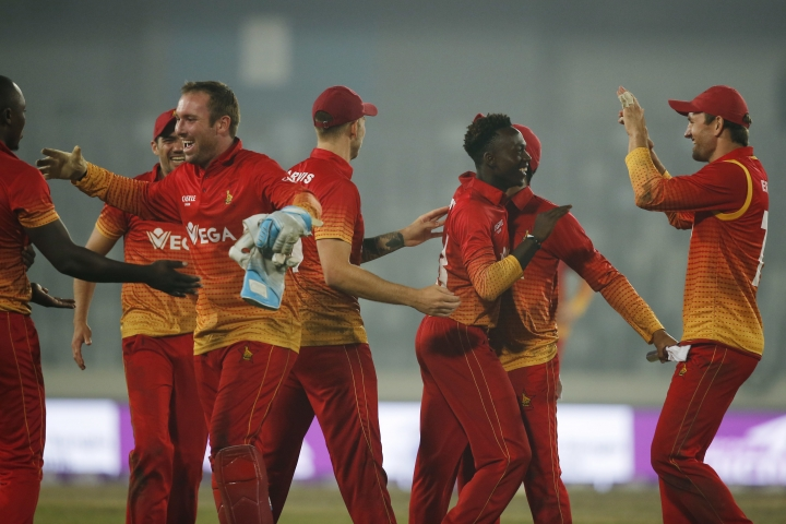 Zimbabwe's players celebrate their victory against Sri Lanka during the Tri-Nation one-day international cricket series in Dhaka, Bangladesh, Wednesday, Jan. 17, 2018. (AP Photo/A.M. Ahad)