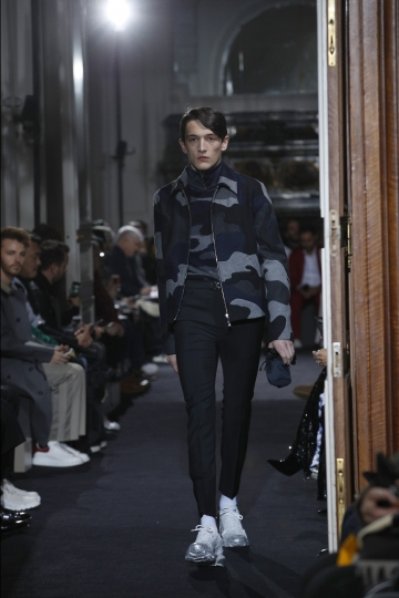 A model wears a creation for Valentino men's Fall-Winter 2018/2019 fashion collection presented in Paris, Wednesday, Jan.17, 2018. (AP Photo/Christophe Ena)