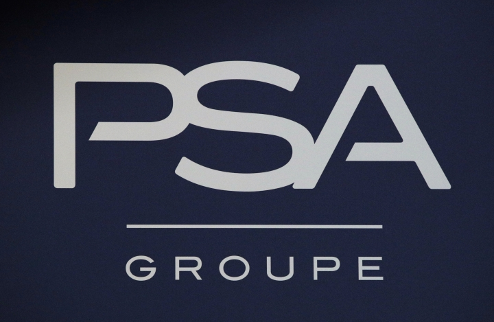 FILE - In this Thursday, Feb. 23, 2017, file photo, the logo of PSA Group is pictured in Paris. The maker of Peugeot and Citroen cars hopes to lay off 1,300 people this year and hire another 1,300 under new labor rules championed by President Emmanuel Macron to give companies more flexibility to hire and fire. SA is among the first big companies to apply the new rules, which came into effect this month. (AP Photo/Christophe Ena, File)
