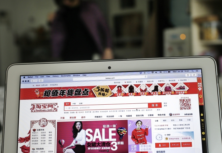 FILE - This Jan. 28, 2015, file photo shows a laptop computer screen displaying the website of Alibaba's Taobao main site at an office in Beijing. China is criticizing recent moves by the U.S. government and Congress targeting the sale of fake goods and Chinese telecoms equipment. Among the Chinese online markets listed was e-commerce giant Alibaba's online marketplace Taobao, which has struggled for years to shed its reputation as an Internet emporium for fake goods. (AP Photo/Andy Wong, File)