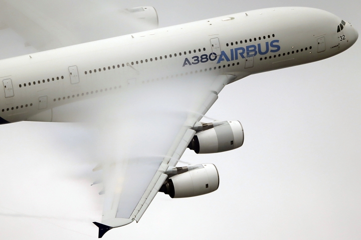 FILE - In this June 18 2015 file photo, vapor forms across the wings of an Airbus A380 as it performs a demonstration flight at the Paris Air Show, Le Bourget airport, north of Paris. Emirates airline said in a statement Thursday, Jan. 18, 2018, that they are purchasing 20 A380 aircraft with the option for 16 more in a deal worth $16 billion, throwing a lifeline to the European-made double-decker jumbo jets. (AP Photo/Francois Mori, File)