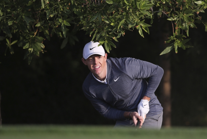 Northern Ireland's Rory McIlroy follows his ball on the 10th hole during the first round of the Abu Dhabi Championship golf tournament in Abu Dhabi, United Arab Emirates, Thursday, Jan. 18, 2018. (AP Photo/Kamran Jebreili)