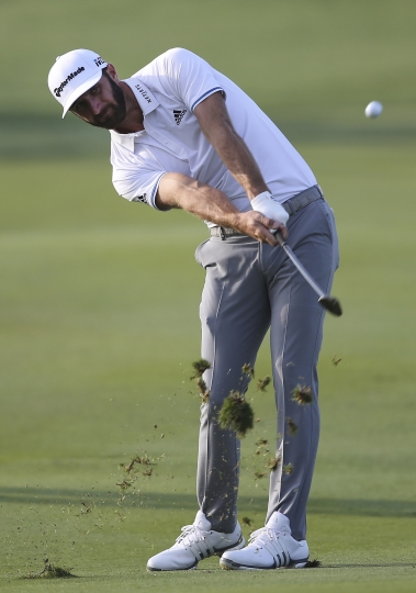 Dustin Johnson of the United States plays a shot on the 13th hole during the first round of the Abu Dhabi Championship golf tournament in Abu Dhabi, United Arab Emirates, Thursday, Jan. 18, 2018. (AP Photo/Kamran Jebreili)