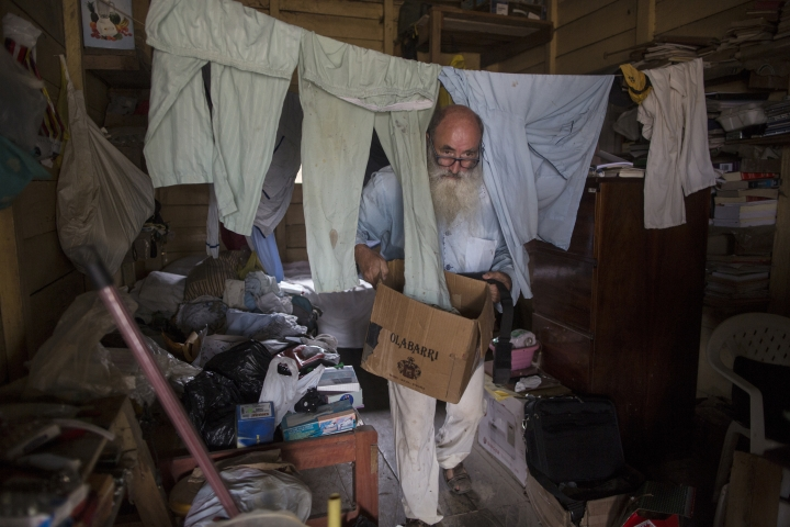 In this Jan. 11, 2018 photo, Father Pablo Zabala, better known as Padre Pablo, cleans up the sleeping quarters where he resides in Boca Colorado, part of Peru's Madre de Dios region in the Amazon. The 70-year-old Spanish priest first traveled to the Amazon in 1978 when, as a young biologist, he collected butterflies and condors for his university's museum in Spain. (AP Photo/Rodrigo Abd)