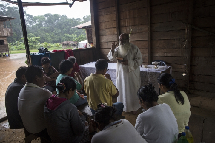 In this Jan. 15, 2018 photo, Father Pablo Zabala, better known as Padre Pablo, celebrates a private Mass for the Aguilar family in Boca Colorado, part of Peru's Madre de Dios province in the Amazon. The 70-year-old Spanish priest drove more than two miles and then walked another to reach the Aguilar family, who wished to give him a sendoff before his transfer to Puerto Maldonado. (AP Photo/Rodrigo Abd)