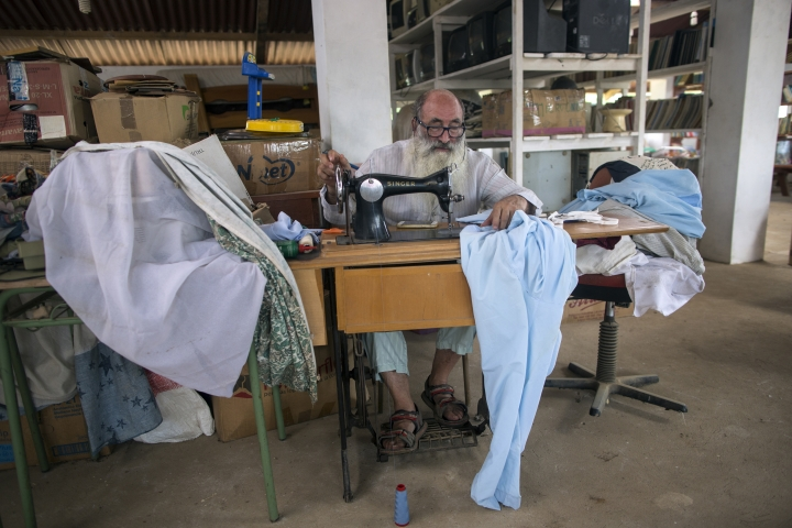In this Jan. 13, 2018 photo, Father Pablo Zabala, better known as Padre Pablo, sews himself a new pair of pajamas at the parish in Boca Colorado, part of Peru's Madre de Dios province in the Amazon. Known for his eccentric style, the 70-year-old Spanish priest often celebrates Mass barefoot, and when not in his cassock can be seen wearing lightweight sleepwear, an outfit he says is ideal for the humid Amazon climate. (AP Photo/Rodrigo Abd)