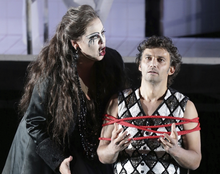 "FILE - In this June 21, 2013, file photo, Jonas Kaufmann, right, in the role of Manrico and Elena Manistina as Azucena sing during a dress rehearsal for the opera ""Il Trovatore"" by Giuseppe Verdi in the Bavarian State Opera House in Munich, southern Germany. The world's most sought-after tenor is back in the United States after a four-year absence caused mostly by illness but partly by a desire to spend more time with his children. (AP Photo/Matthias Schrader, File)"