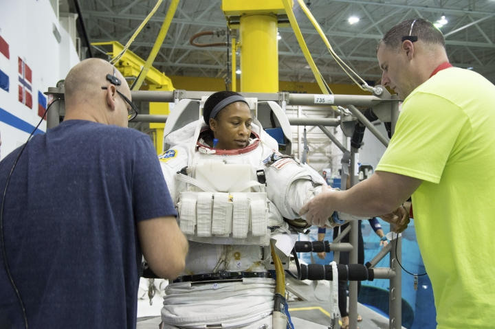 In this Sept. 16, 2014 photo provided by NASA, astronaut Jeanette Epps participates in a spacewalk training session at the Johnson Space Center in Houston. In June 2018, Epps was supposed to be the first African-American to live on the International Space Station, but on Thursday, Jan. 18, 2018, NASA announced it was pulling her off the mission for undisclosed reasons. (Robert Markowitz/NASA via AP)