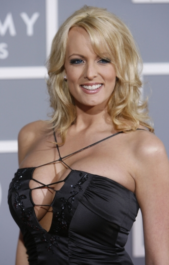 FILE - In this Feb. 11, 2007 file photo, Stormy Daniels arrives for the 49th Annual Grammy Awards in Los Angeles. A tabloid magazine held back from publishing an adult film star's 2011 account of an alleged affair with Donald Trump after the future president's personal lawyer threatened to sue, four former employees of tabloid's publisher told The Associated Press. In Touch magazine published its 5,000-word interview with the pornographic actor Stormy Daniels on Friday. (AP Photo/Matt Sayles)