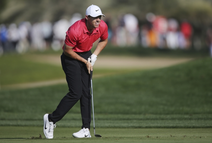 Northern Ireland's Rory McIlroy follows his ball on the 16th hole during the third round of the Abu Dhabi Championship golf tournament in Abu Dhabi, United Arab Emirates, Saturday, Jan. 20, 2018. (AP Photo/Kamran Jebreili)