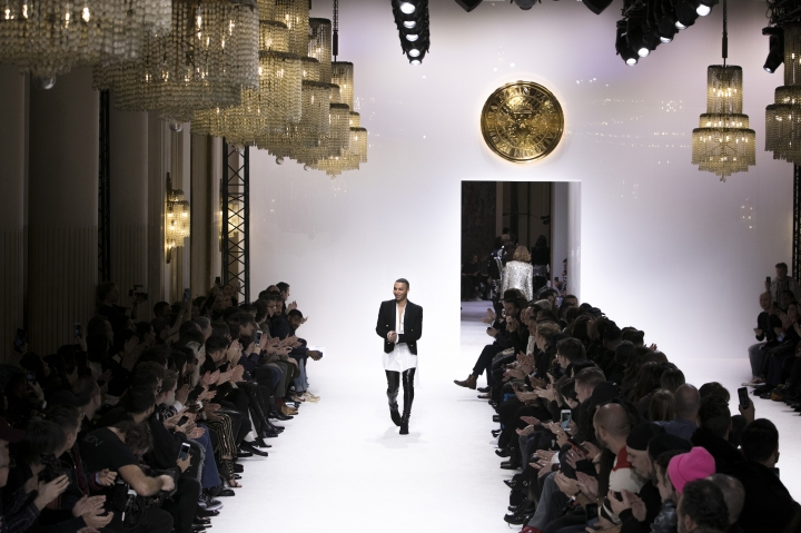 Designer Olivier Rousteing accepts applause at the end of the Balmain men's Fall-Winter 2018/2019 fashion collection presented in Paris, Saturday, Jan.20, 2018. (AP Photo/Kamil Zihnioglu)