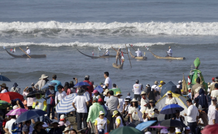 Fisherman paddle in their woven reed vessels known as caballito de Totoras as they wait for the arrival of Pope Francis to celebrate Mass on Huanchaco Beach, near the city of Trujillo, Peru, Saturday, Jan. 20, 2018. Francis travels Saturday to northern Peru, where the pontiff will celebrate Mass and ride through a hard-hit neighborhood still reeling from disastrous rains that hit nearly a year ago. (AP Photo/Martin Mejia)