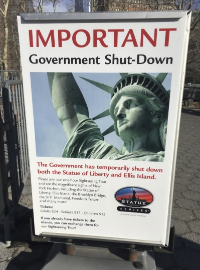 "The sign at the Ellis Island ferry cue informs visitors that there was no access to the island or to the Statue of Liberty, due to the government shutdown, Saturday, Jan. 20, 2018 in New York. When a dispute in Congress over spending and immigration forced scores of federal government agencies and outposts to close their doors, the Statue of Liberty and Ellis Island had to turn away visitors, due to what the National Park Service described as ""a lapse in appropriations."" (AP Photo/Ted Shaffrey)"