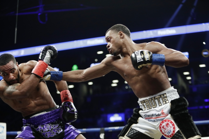 Errol Spence Jr., right, hits Lamont Peterson during the second round of an IBF welterweight championship boxing match Saturday, Jan. 20, 2018, in New York. Spence stopped Peterson in the eighth round. (AP Photo/Frank Franklin II)