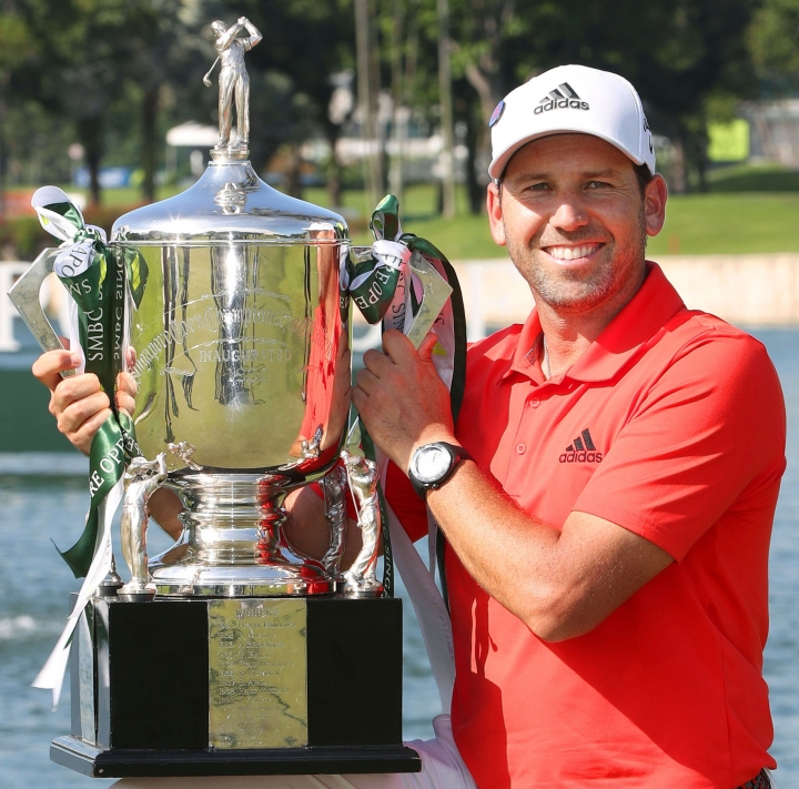 Spain's Sergio Garcia poses with his trophy after wining the Singapore Open golf tournament at the Sentosa Golf Club in Singapore Sunday, Jan. 21, 2018. Garcia shot a final round of 3-under 68 to finish at 14-under 270 and capture his 33rd professional title. (Kyodo News via AP)