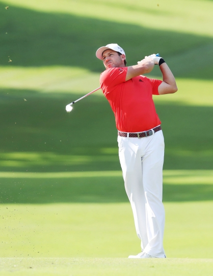 Spain's Sergio Garcia hits a shot on the first hole during the Singapore Open golf tournament at the Sentosa Golf Club in Singapore Sunday, Jan. 21, 2018. Garcia shot a final round of 3-under 68 to finish at 14-under 270 and capture his 33rd professional title. (Kyodo News via AP)
