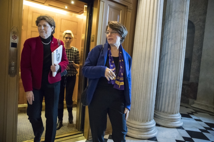 Sen. Jeanne Shaheen, D-N.H., left, and Sen. Amy Klobuchar, D-Minn., arrive at the Capitol following a meeting of moderate senators on Day 2 of the federal shutdown, at the Capitol in Washington, Sunday, Jan. 21, 2018. (AP Photo/J. Scott Applewhite)