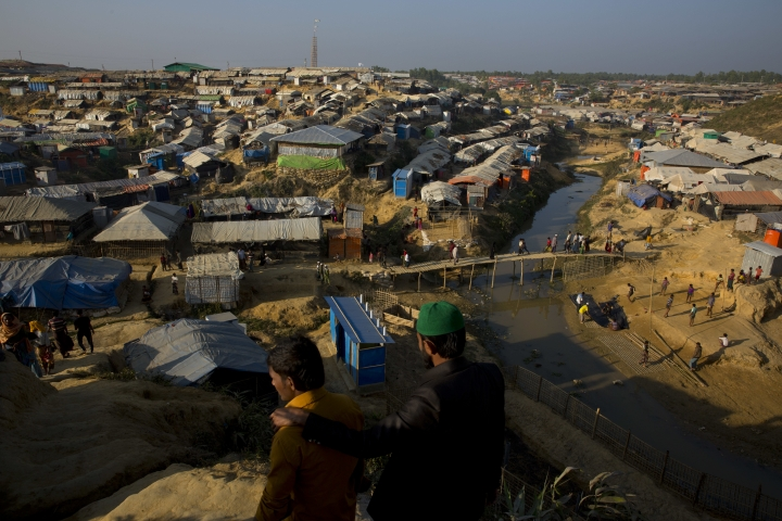 In this Friday, Jan. 19, 2018, photo, an overview of Rohingya refugees squalid camp near Cox's Bazar, Bangladesh. With the first repatriations of Rohingya refugees back to Myanmar just days away, and more than 1 million living in refugee camps in Bangladesh, international aid workers, local officials and the refugees say preparations have barely begun and most refugees would rather contend with the squalor of the camps than the dangers they could face if they return home. It's unclear if more than a handful of Rohingya will even be willing to go home. (AP Photo/Manish Swarup)