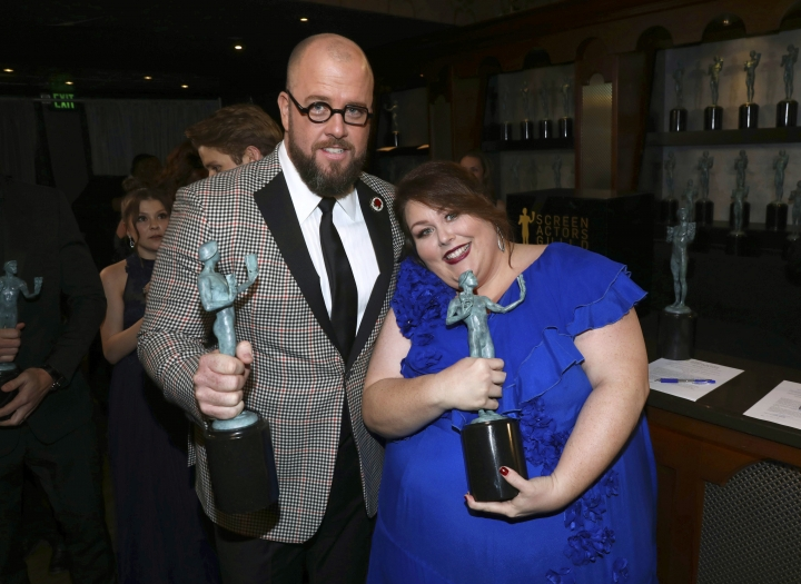 """Chris Sullivan, left, and Chrissy Metz pose with the award for outstanding performance by an ensemble in a drama series for """"This Is Us"""" at the 24th annual Screen Actors Guild Awards at the Shrine Auditorium & Expo Hall on Sunday, Jan. 21, 2018, in Los Angeles. (Photo by Matt Sayles/Invision/AP)"""