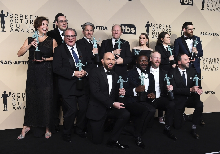 """Julie White, from back row left, Kevin Dunn, Nelson Franklin, Gary Cole, Dan Bakkedahl, Sarah Sutherland, Clea Du Vall, Timothy Simons, Paul Scheer, Sam Richardson, Matt Walsh, and Tony Hale, winners of the award for outstanding ensemble in a comedy series for """"Veep"""", pose in the press room at the 24th annual Screen Actors Guild Awards at the Shrine Auditorium & Expo Hall on Sunday, Jan. 21, 2018, in Los Angeles. (Photo by Jordan Strauss/Invision/AP)"""
