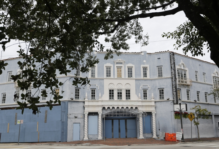 In this Tuesday, Jan. 9, 2018 photo, is the Coconut Grove Playhouse, a once luxurious movie theater constructed in the Spanish Rococo style in the 1920s, in the Coconut Grove neighborhood of Miami. It was remodeled in the late 1950s and served as a performing arts center. Although closed, several proposals to revive the theater are being considered. The oasis that is Coconut Grove is just a few miles from downtown, along the shore of Biscayne Bay, with tree canopies shading the streets and historic structures scattered throughout.(AP Photo/Lynne Sladky)