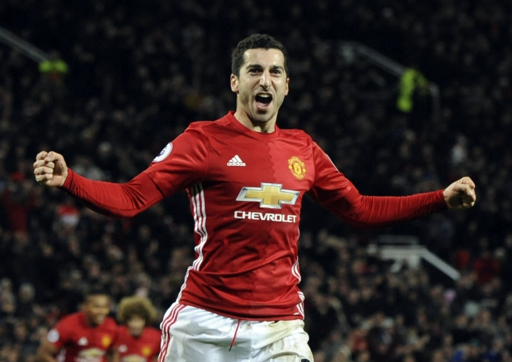 FILE - In this Monday, Dec. 26, 2016 file photo, Manchester United's Henrikh Mkhitaryan celebrates after scoring his side's third goal during their English Premier League soccer against Sunderland at Old Trafford in Manchester, England. Alexis Sanchez is close to joining Manchester United in what is set to be a rare swap deal among two of England's top teams that will see Henrikh Mkhitaryan move to Arsenal.Both players were pictured by British newspapers Monday, Jan. 22, 2018 entering an office in Liverpool to update their work permits. (AP Photo/Rui Vieira, file)