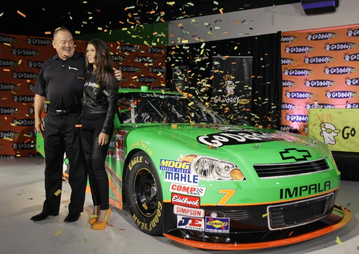 FILE - In this Aug. 25, 2011, file photo, Go Daddy.com founder Bob Parsons, left, sponsor for NASCAR driver Danica Patrick, right, unveil Patrick's car she will drive full-time in the NASCAR Nationwide Series circuit and select Sprint Cup races during an auto racing news conference, in Scottsdale, Ariz. Patrick is teaming with Premium Motorsports for next month's Daytona 500, the final race of her NASCAR career. The one-race deal will put Patrick in the seat of the No. 7 GoDaddy Chevrolet, the same car number she drove when she entered stock-car racing in 2010. (AP Photo/Paul Connors, File)