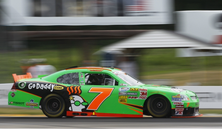 FILE - In this June 23, 2012, file photo, Danica Patrick races during the NASCAR Nationwide Series Sargento 200 auto race at Road America in Elkhart Lake, Wisc. Patrick is teaming with Premium Motorsports for next month's Daytona 500, the final race of her NASCAR career. The one-race deal will put Patrick in the seat of the No. 7 GoDaddy Chevrolet, the same car number she drove when she entered stock-car racing in 2010. (AP Photo/Jeffrey Phelps, File)