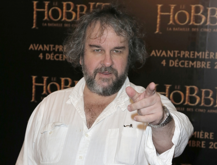 FILE - In this file photo dated Thursday, Dec. 4, 2014, director Peter Jackson poses for photos at the screening of his film The Hobbit. It is announced Monday Jan. 22, 2018, that Jackson is transforming grainy black-and-white archive film from the London Imperial War Museum using cutting-edge digital technology and hand coloring to transform World War I film into 3-D color, to mark the centenary of the 1914-18 conflict. (AP Photo/Francois Mori, FILE)