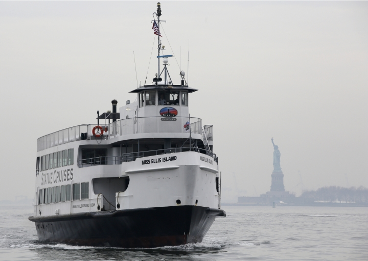 A Statue of Liberty and Ellis Island tour boat returns to Battery Park after dropping passengers off at the Statue of Liberty, Monday, Jan. 22, 2018, in New York. The Statue of Liberty and Ellis Island opened for visitors Monday, with New York state picking up the tab for the federal workers during the government shutdown. (AP Photo/Kathy Willens)