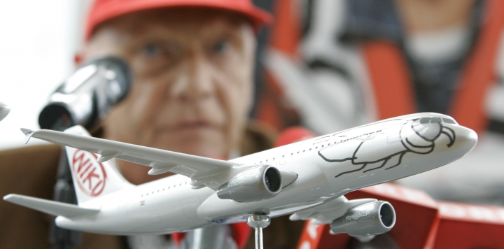 "FILE - In this Sept. 14, 2009 file photo former Formula One champion and then head of the airline ""Fly Niki"" Niki Lauda speaks behind an airplane model during a news conference about expansion plans in Vienna. Austrian media reported Tuesday, Jan. 23, 2018 that the board of creditors allowed Niki Lauda to buy Austrian Niki airline which had become a daughter of insolvent German airline Air Berlin. (AP Photo/Lilli Strauss, file)"