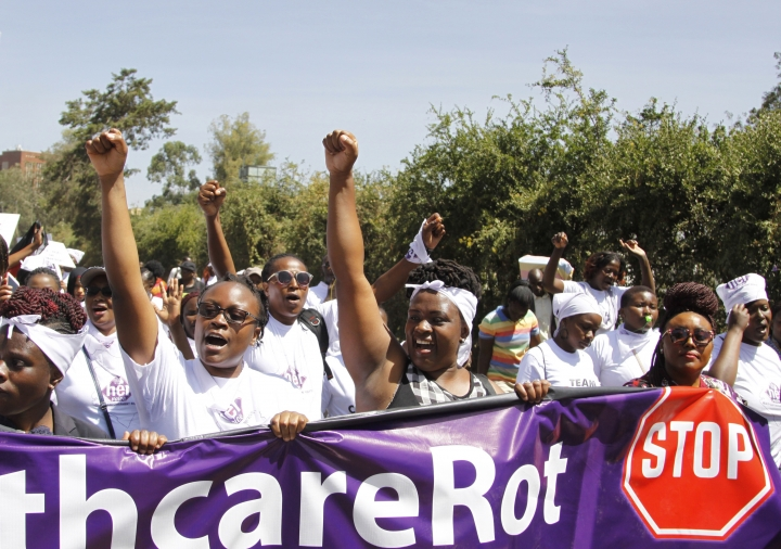 Protesters march along the streets of Nairobi holding placards against the rape allegation by staff of Kenyatta national hospital in Nairobi, Kenya Tuesday, Jan. 23, 2018. Protesters allege it is difficult for victims of sexual assault to go to police, and want swift investigations while demanding changes to make women safe at hospital. (AP Photo/Khalil Senosi)