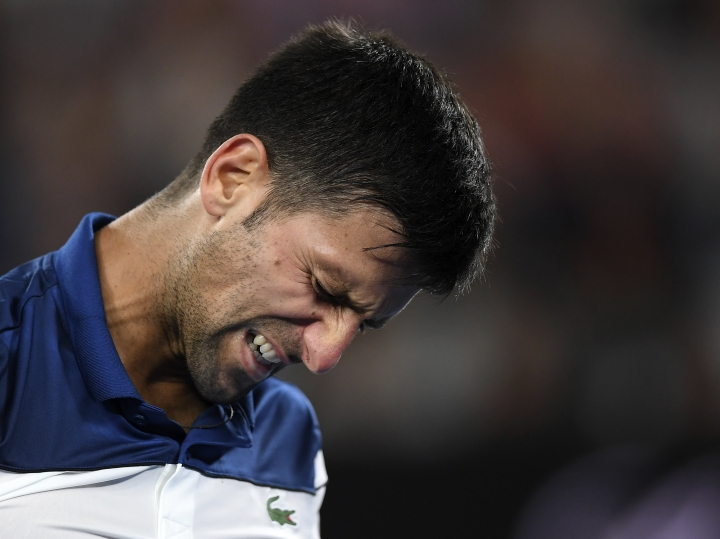 Serbia's Novak Djokovic grimaces during his fourth round match against South Korea's Chung Hyeon at the Australian Open tennis championships in Melbourne, Australia, Monday, Jan. 22, 2018. (AP Photo/Andy Brownbill)