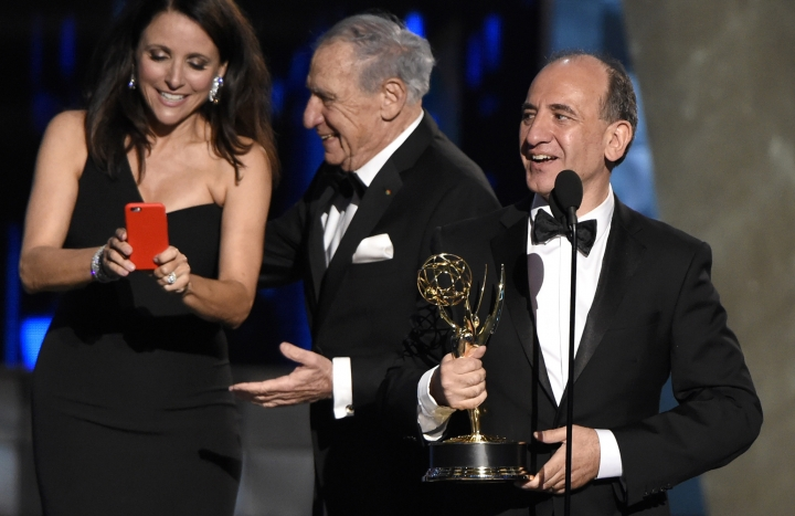 "FILE - This is a Sunday, Sept. 20, 2015 file photo of Armando Iannucci, right, as he receives the award for outstanding comedy series ""Veep"" from Julia Louis-Dreyfus, Mel Brooks at the 67th Primetime Emmy Awards at the Microsoft Theater in Los Angeles. Russia's Culture Ministry on Tuesday Jan. 23, 2017 banned Armando Iannucci's satirical film about Soviet dictator Josef Stalin's death two days before its scheduled release. (Photo by Chris Pizzello/Invision, File AP)"