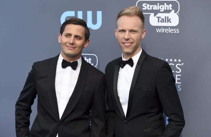 """FILE - In this Jan. 11, 2018 file photo, Benj Pasek, left, and Justin Paul arrive at the 23rd annual Critics' Choice Awards in Santa Monica, Calif. The pair were nominated for an Oscar for best original song for """"This Is Me,"""" from the film """"The Greatest Showman."""" (Photo by Jordan Strauss/Invision/AP, File)"""
