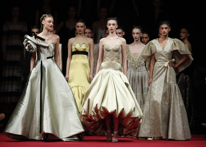Models wear creations for French fashion designer Alexis Mabille's Haute Couture Spring-Summer 2018 fashion collection, presented in Paris, Tuesday, Jan.23, 2018. (AP Photo/Francois Mori)