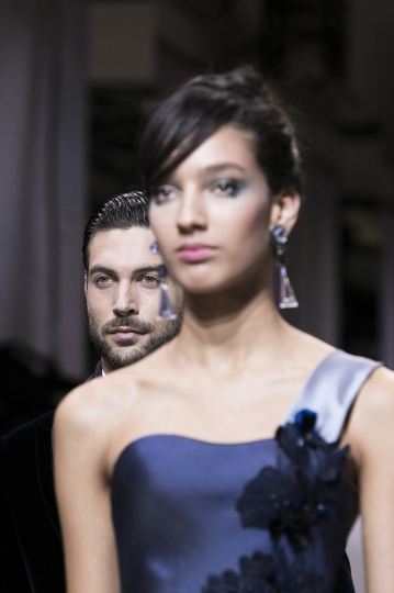 Models wear creations for Giorgio Armani's Haute Couture Spring-Summer 2018 fashion collection presented in Paris, Tuesday, Jan. 23, 2018. (AP Photo/Kamil Zihnioglu)