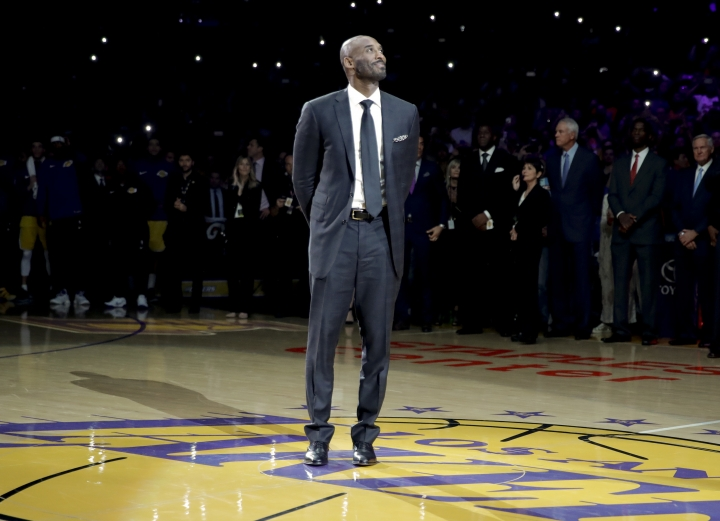 "FILE - In this Dec. 18, 2017 file photo, former Los Angeles Laker Kobe Bryant arrives for a halftime ceremony, retiring both of his jersey's during an NBA basketball game between the Los Angeles Lakers and the Golden State Warriors, in Los Angeles. Bryant is nominated for an Oscar in the animated short category for ""Dear Basketball,"" based on a poem he wrote in 2015 announcing his impending retirement from basketball. (AP Photo/Chris Carlson, File)"