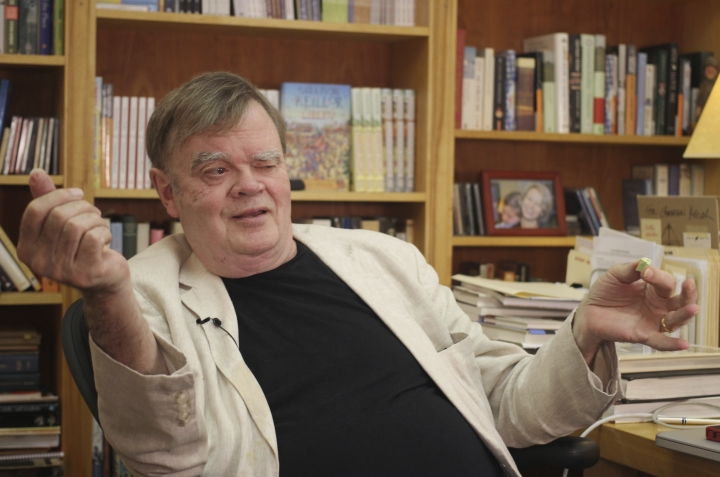 "FILE - In this July 26, 2017 file photo, Garrison Keillor, creator and former host of, ""A Prairie Home Companion,"" talks at his St. Paul, Minn., office. Minnesota Public Radio provided additional details of allegations of sexual harassment against Keillor on Tuesday, Jan. 23, 2018, saying his alleged conduct went well beyond his account of an accidental touch of a woman's bare back. MPR said in a statement that Keillor was accused by a woman who worked on his ""A Prairie Home Companion"" radio show of dozens of sexually inappropriate incidents over several years, including requests for sexual contact and explicit sexual communications and touching. (AP Photo/Jeff Baenen, File)"