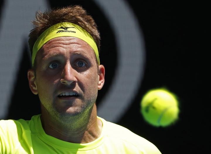 United States' Tennys Sandgren looks to make a forehand return to South Korea's Chung Hyeon during their quarterfinal at the Australian Open tennis championships in Melbourne, Australia, Wednesday, Jan. 24, 2018. (AP Photo/Ng Han Guan)