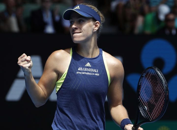 Germany's Angelique Kerber celebrates after defeating United States' Madison Keys in their quarterfinal at the Australian Open tennis championships in Melbourne, Australia, Wednesday, Jan. 24, 2018. (AP Photo/Ng Han Guan)