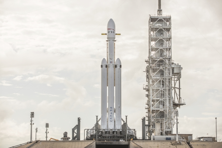 This Dec. 28, 2017 photo made available by SpaceX shows a Falcon Heavy rocket at Cape Canaveral, Fla. On Wednesday, Jan. 24, 2018, the rocket's three boosters — 27 engines in all — were tested. SpaceX is aiming for a February launch. (SpaceX via AP)