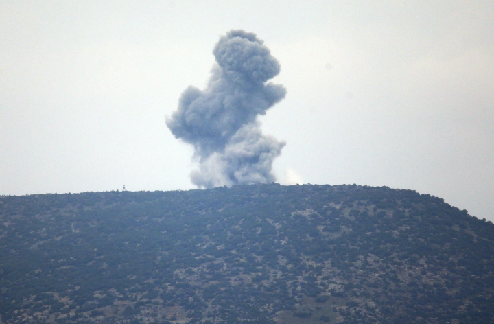 """A plume of smoke from an air bombardment rises from an impact inside Syria as seen from the Hatay province, Turkey, near the border Wednesday, Jan. 24, 2018. Turkey's President Recep Tayyip Erdogan said Wednesday its military offensive into a Kurdish-held enclave in northern Syria is progressing """"successfully"""" and will continue until the last """"terrorist is eliminated"""". (AP Photo/Lefteris Pitarakis)"""