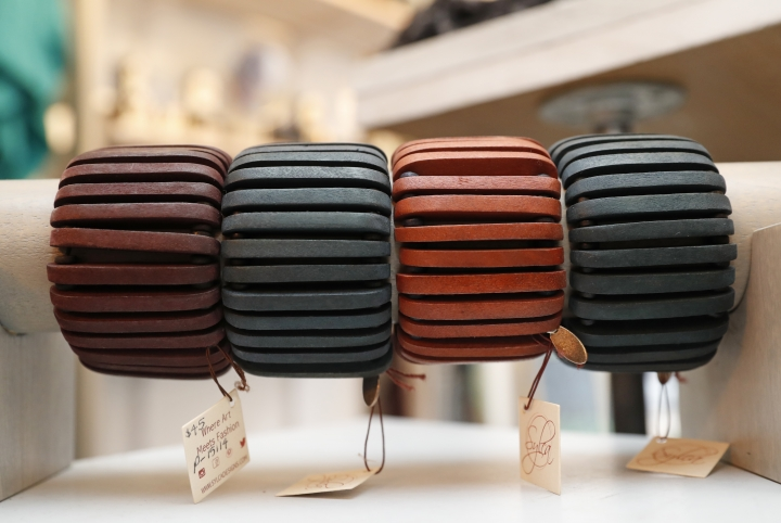 "Wooden bangles are displayed at Bhoomki, a store specializing in ""ethically-fashioned"" and hand-crafted clothing and jewelry, Tuesday, Jan. 23, 2018, in New York. The digital age has opened opportunities for artisans, giving rise to a growing number of ventures designed to create online markets for crafts from Bali to rural Kyrgyzstan. (AP Photo/Kathy Willens)"