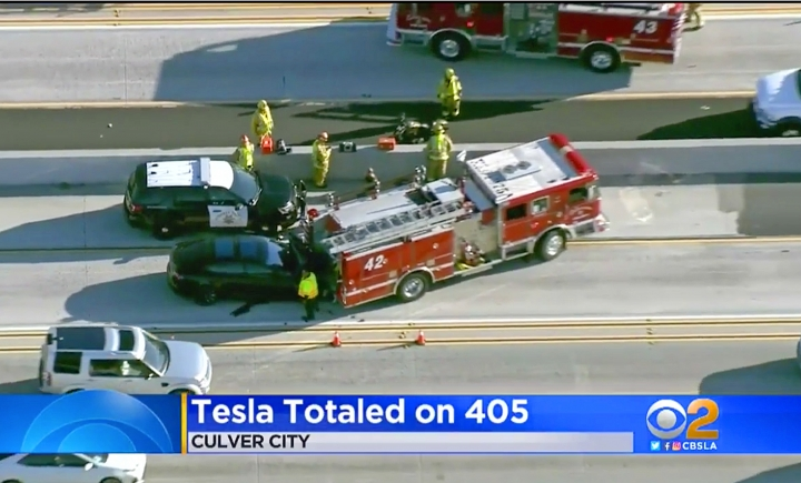 "This Monday, Jan. 22, 2018 still frame from video provided by KCBS-TV shows a Tesla Model S electric car that has crashed into a fire engine on Interstate 405 in Culver City, Calif. Two federal agencies have dispatched teams to investigate the crash of the car that may have been operating under its semi-autonomous ""Autopilot"" system. National Transportation Safety Board send investigators to Culver City on Tuesday, while the National Highway Traffic Safety Administration confirmed Wednesday, Jan. 24, that it is also dispatching a special team ""to investigate the crash and assess lessons learned."" (KCBS-TV via AP)"